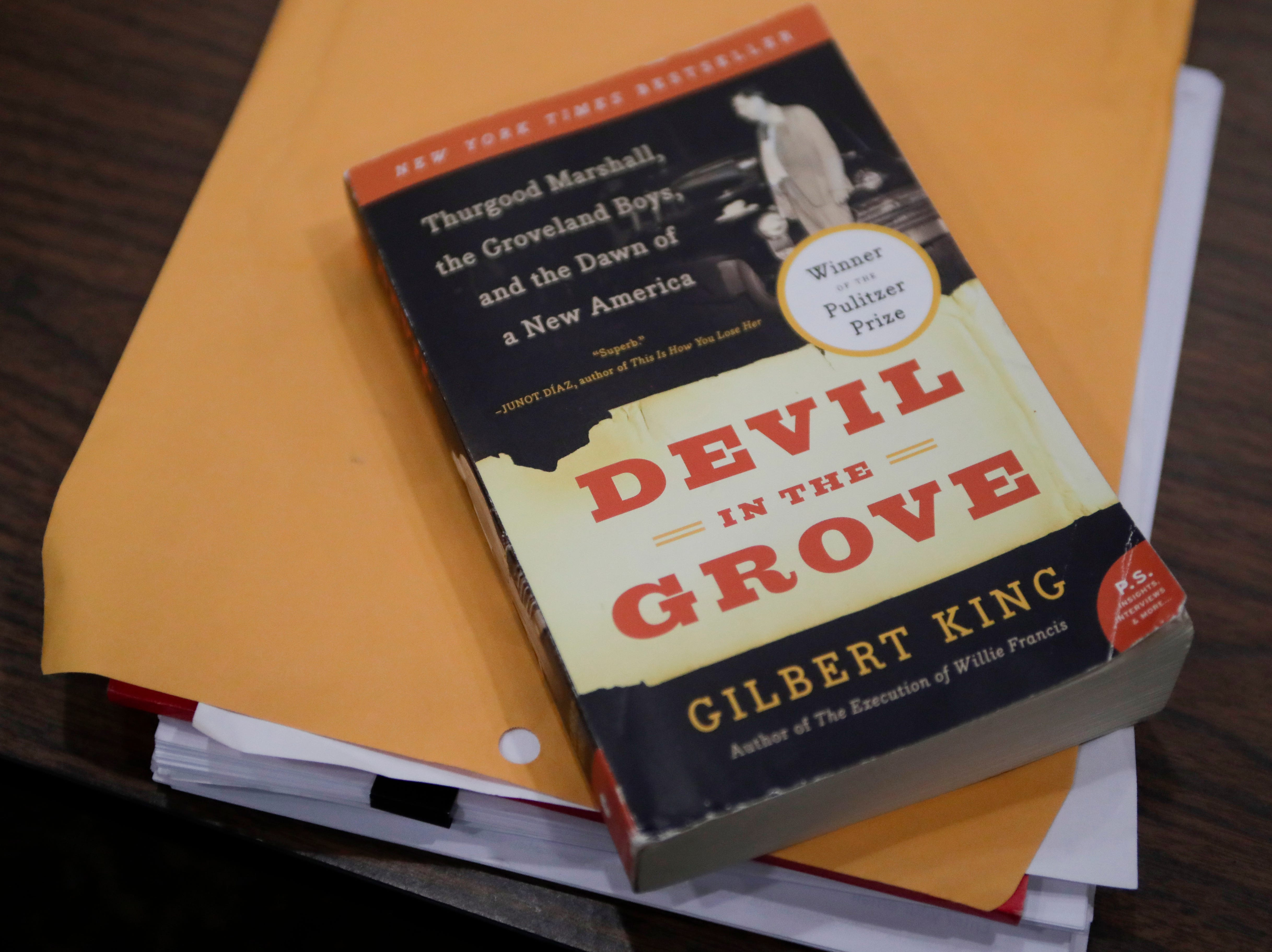 "A copy of ""Devil in the Grove"" sits on a table in the cabinet room of the Florida State Capitol after Gov. Ron DeSantis and his cabinet granted pardons to the Groveland Four, the subjects of the book Friday, Jan. 11, 2019."