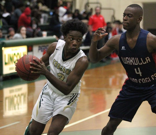 Lincoln's Andrew Sherman drives baseline as Wakulla's Trevon Hale guards during a game at Lincoln on Jan. 10, 2019.