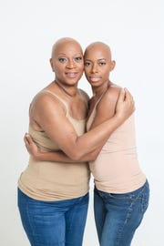 Pam Moore with her daughter Mikaya Warren, after treatment for breast cancer.