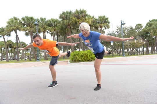 It's a balancing act for runners Bart Peikarski and Kelly Peters the Fort Pierce Sunrise Kiwanis Club's Bridge Buster 5K on Jan. 5.