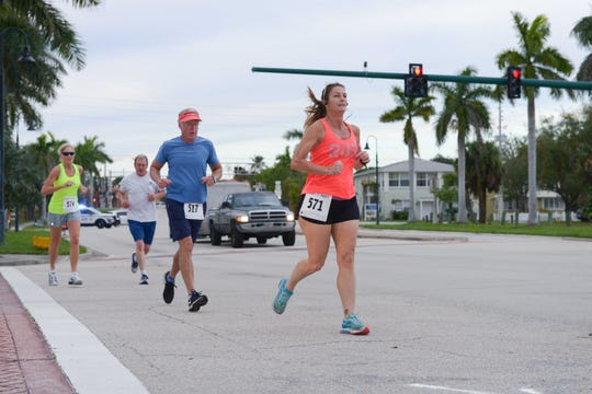 Lisa Sierra of Jensen Beach runs ahead of some others at the Fort Pierce Sunrise Kiwanis Club's Bridge Buster 5K on Jan. 5.