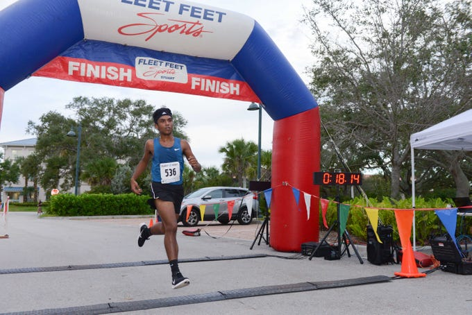 Port St. Lucie's Khan Imran is the first runner to cross the finish line of the Fort Pierce Sunrise Kiwanis Club's Bridge Buster 5K on Jan. 5.