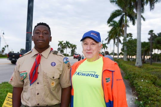 Boy Scout Trey Barron of Troop 475 with Kiwanian Marcia Cully at the Fort Pierce Sunrise Kiwanis Club's Bridge Buster 5K.