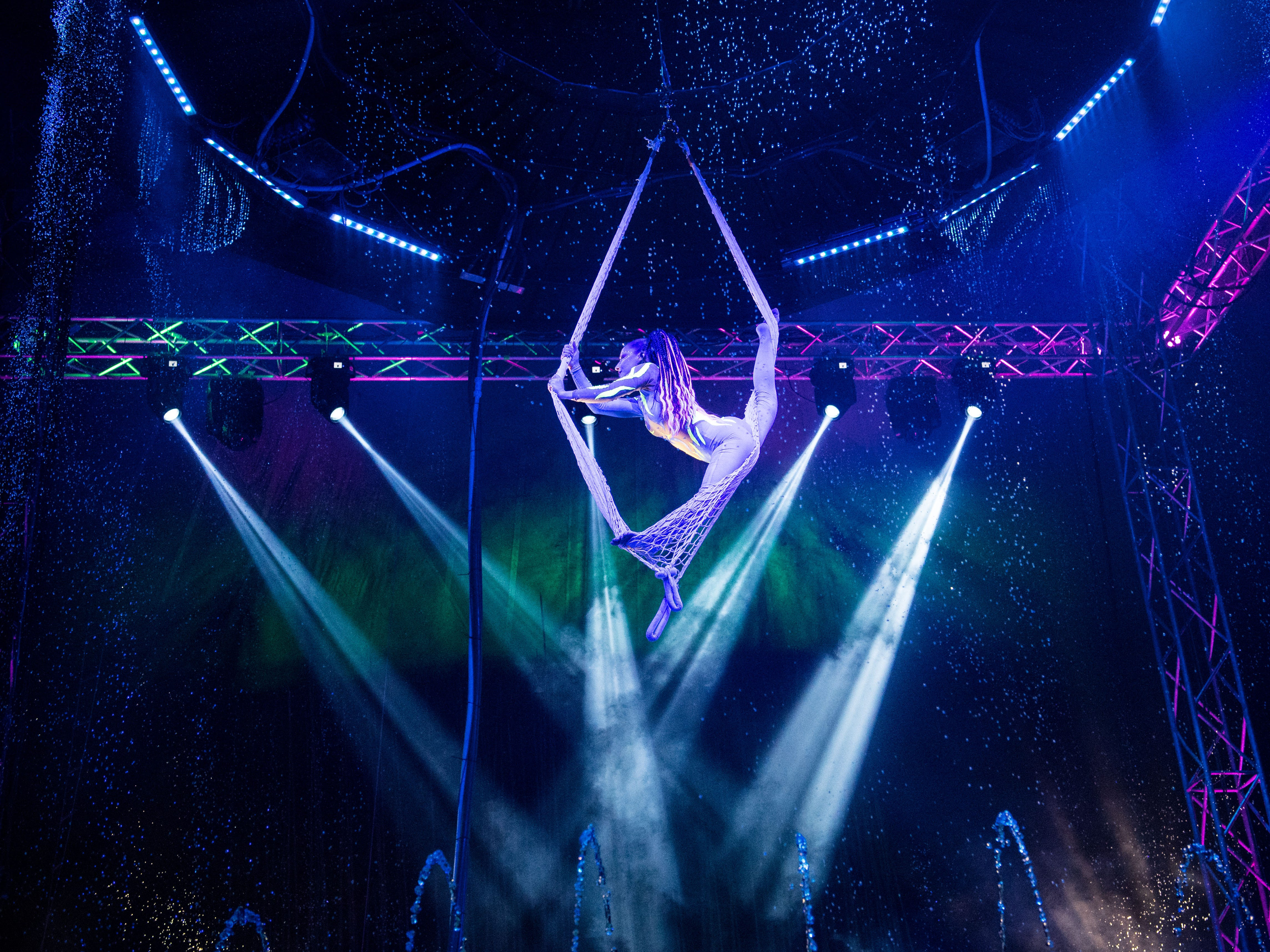 "Cirque Italia's Corissa Wilson-Fusco performs a dramatic routine that began with her trapped in a net during opening night Thursday, Jan. 10, 2019, outside First Data Field in Port St. Lucie. Cirque Italia's ""Aquatic Spectacular,"" named for the custom designed water-stage that holds 35,000 gallons of water, will continue through Sunday, Jan. 13. Go to www.cirqueitalia.com for ticket prices and showtimes."