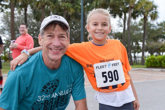 Kiwanian and Fort Pierce City Commissioner Tom Perona with Luci Galinis, the youngest contestant in the Fort Pierce Sunrise Kiwanis Club's Bridge Buster 5K on Jan. 5.