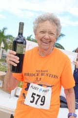 87-year-old Marilyn Walters wins a prize at the Fort Pierce Sunrise Kiwanis Club's Bridge Buster 5K on Jan. 5.