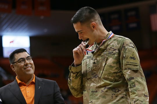 Fort Bliss Army Sgt. Trey Troney was given a hometown hero medal at a UTEP basketball game for allegedly helping save an injured driver after a crash in an account that is now questioned.