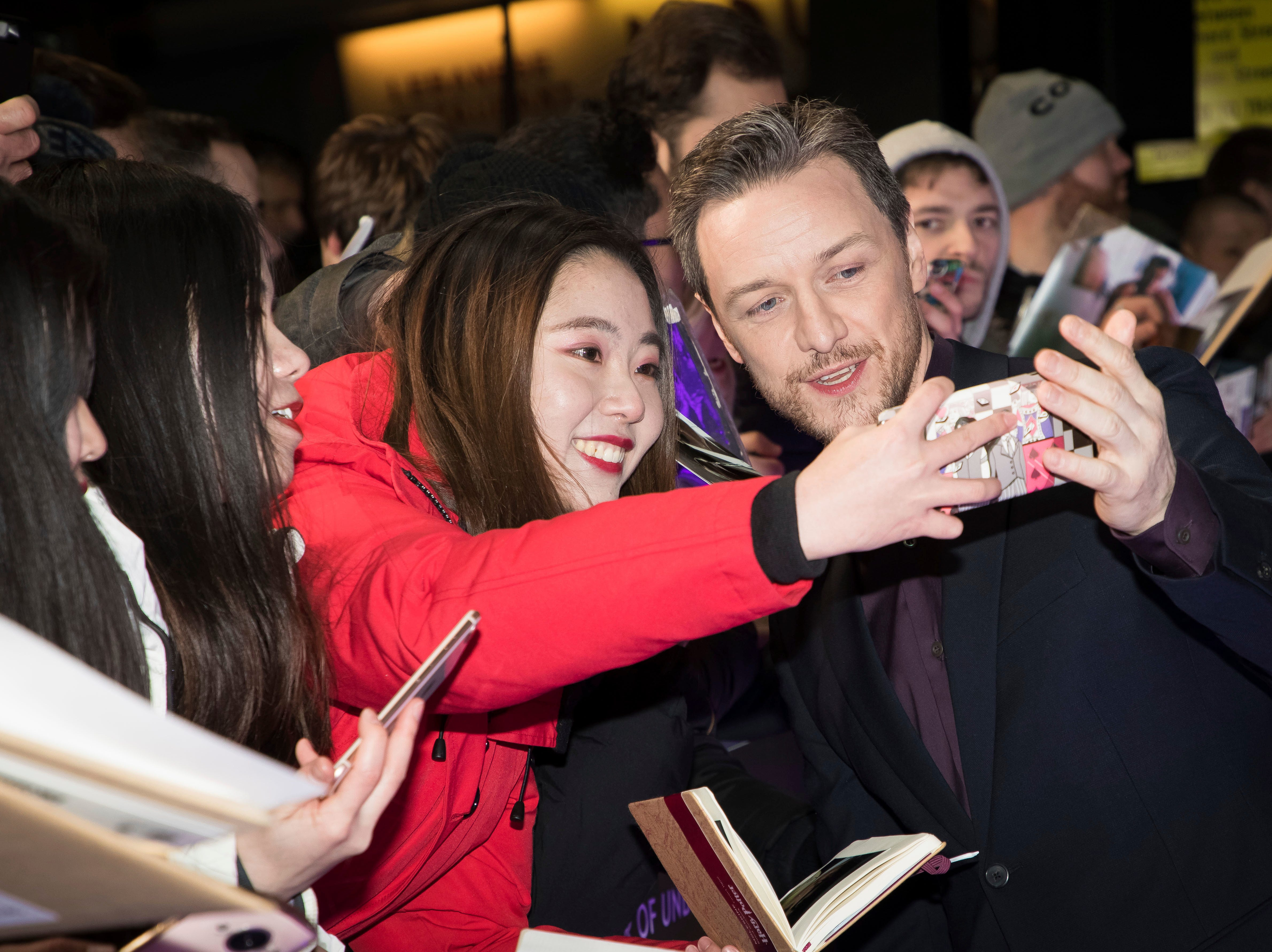 """Actor James McAvoy poses for photographs with fans upon arrival at the premiere of the film """"Glass"""" in London on Wednesday, Jan. 9, 2019."""