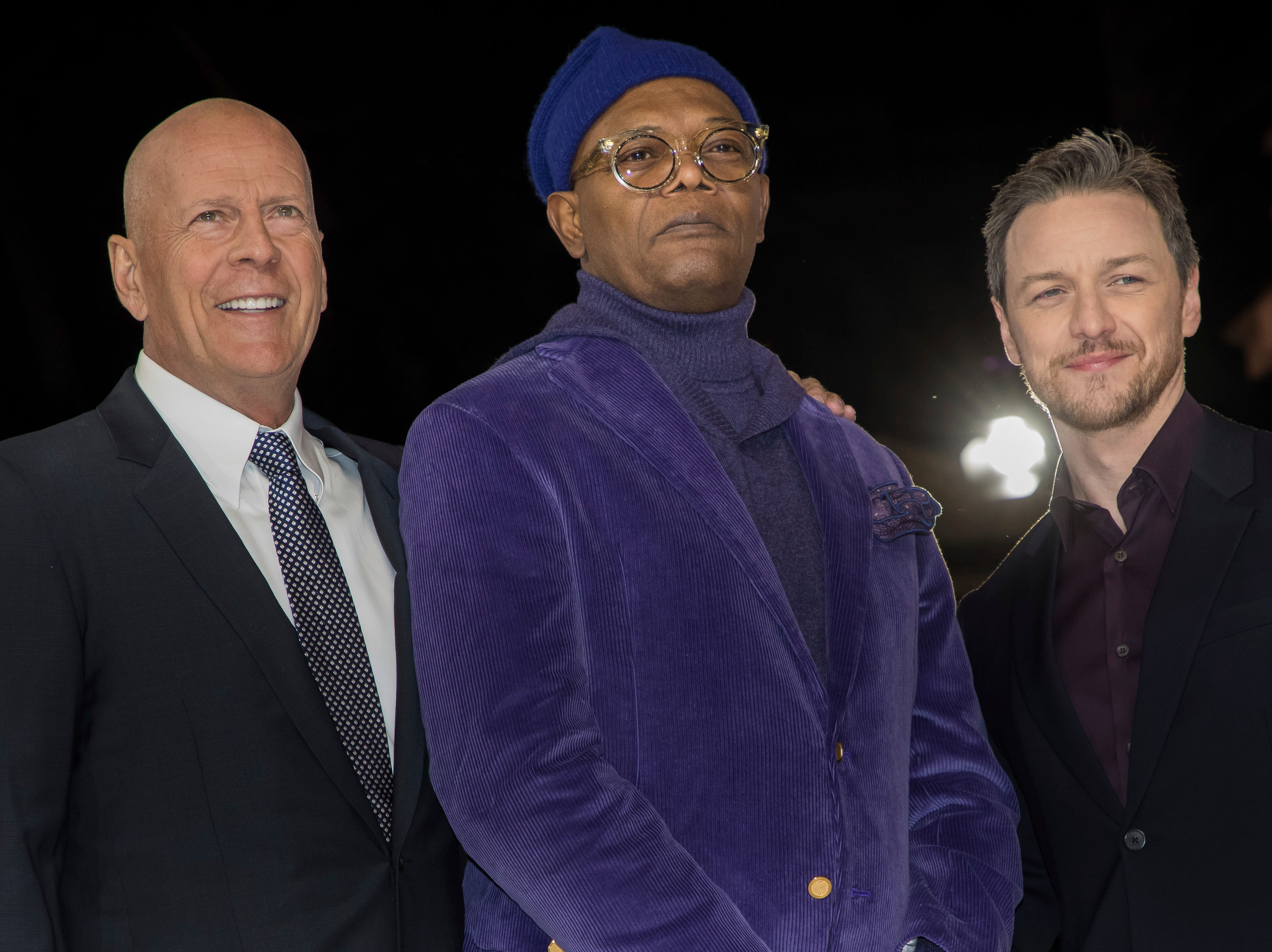 """Actors Bruce Willis, from left, Samuel L. Jackson and James McAvoy pose for photographers upon arrival at the premiere of the film """"Glass"""" in London on Wednesday, Jan. 9, 2019."""