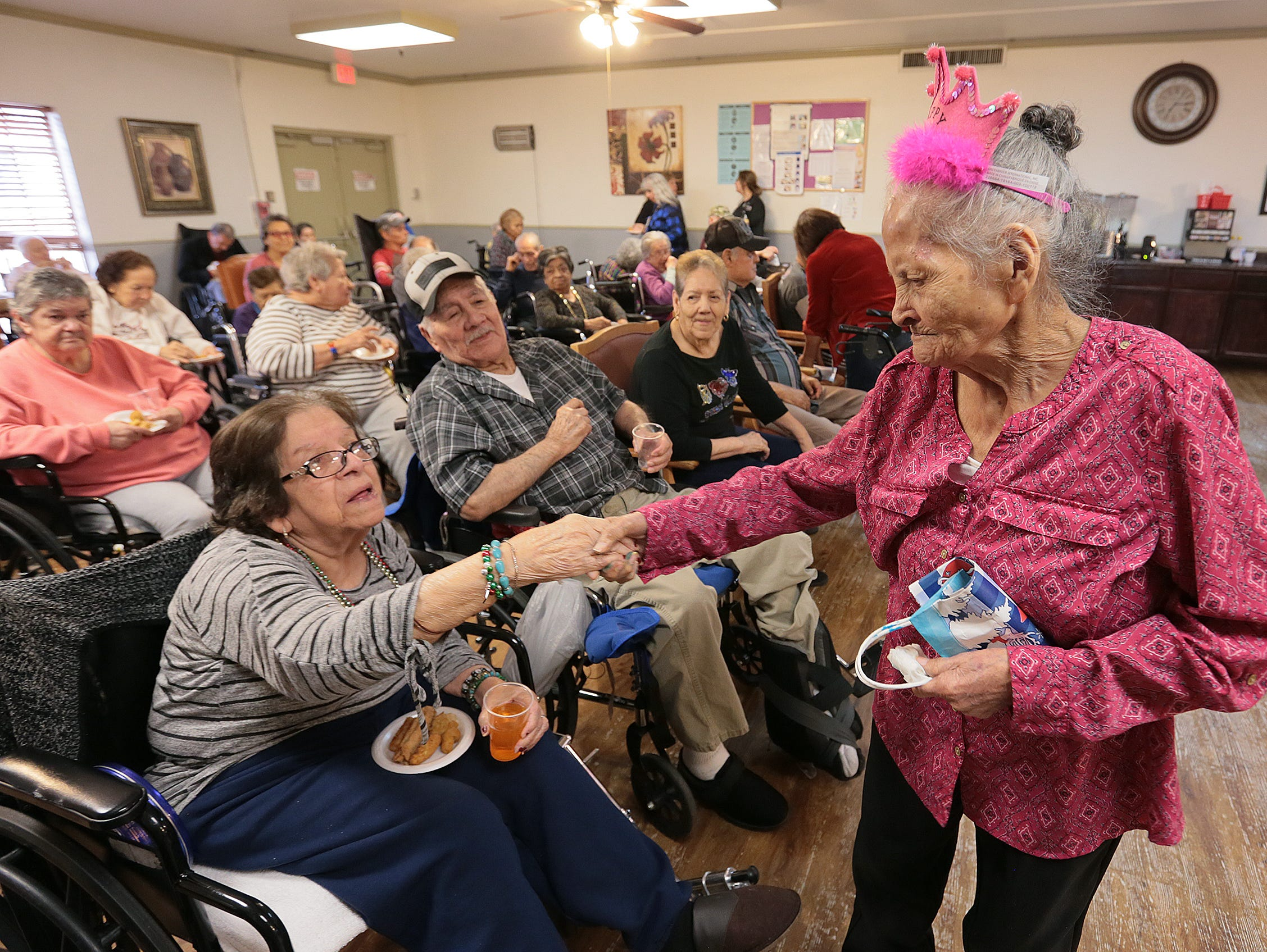 El Pasoan Maria de la Luz Angel Talamantes celebrates her 110th birthday Friday with fellow residents at Oasis Nursing and Rehabilitation Center.