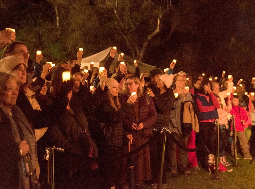 A candlelight march proceeded from Manning Park to All Saints Church.