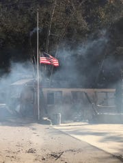 This American flag, at half-staff for the victims of the Borderline Bar & Grill shooting, is all that still stands at Camp Bloomfield after the Woolsey Fire. The site has long been used by the Conejo Valley Unified School District to give sixth-graders a nature experience.