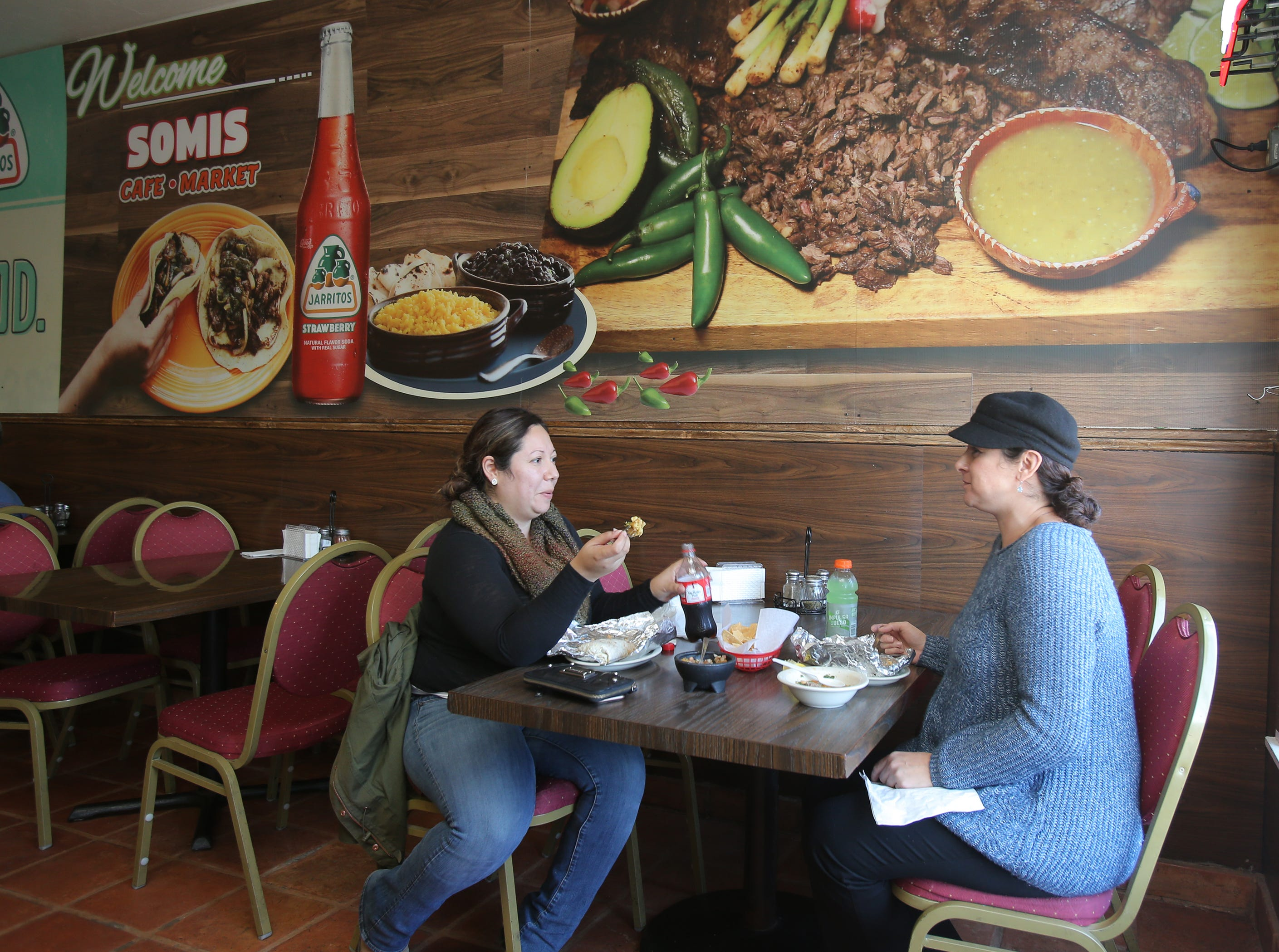 Letty Hernandez, left, of Oxnard and Ava Gonzales, of Camarillo, eat lunch at the Somis Café and Market.
