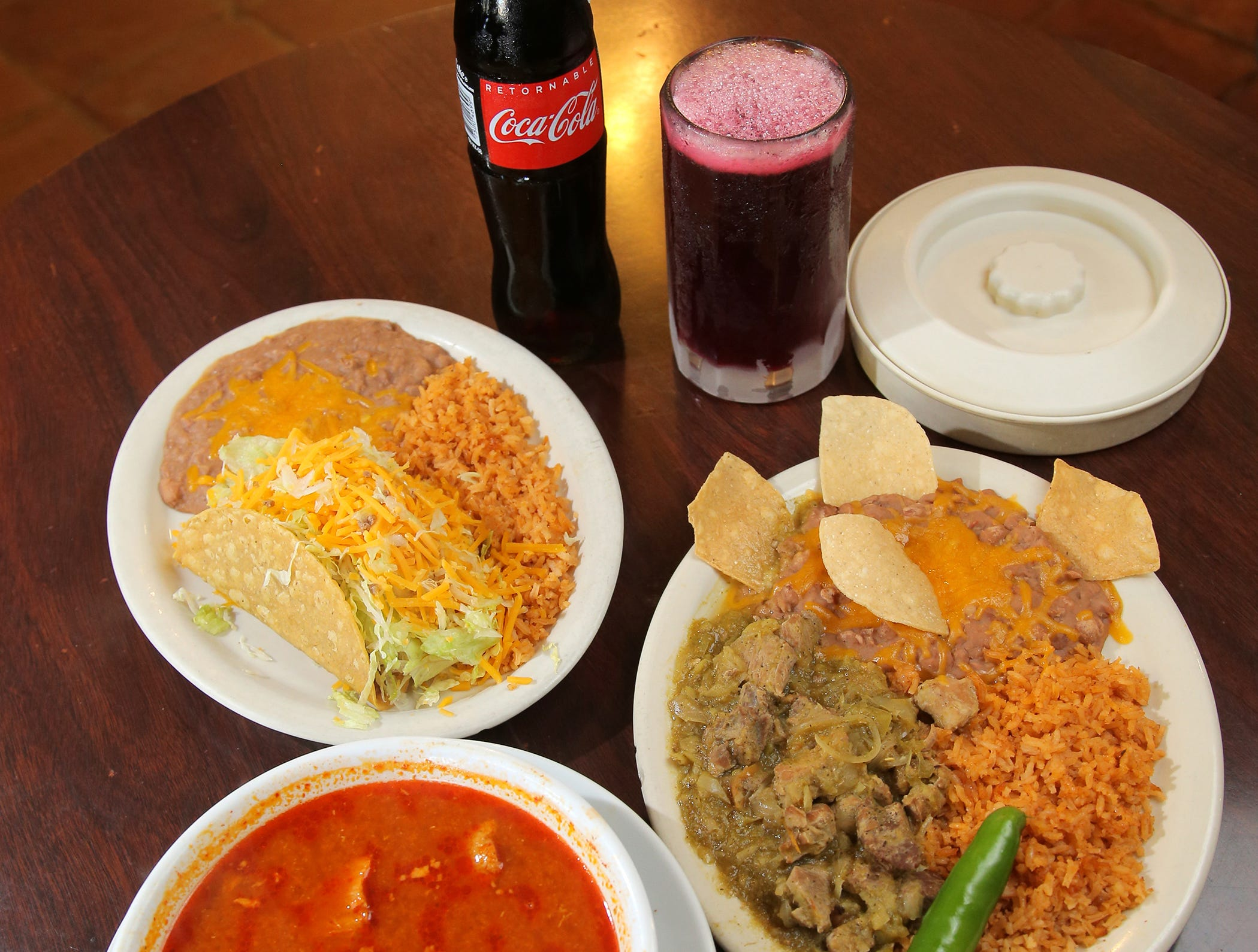 The Somis Café and Market has long been known for its large selection of authentic Mexican food. Pictured is its popular pozole soup, chile verde plate and a ground beef taco plate. It has  serves Coca-Cola from Mexico and the traditional Mexican drink Jamaica.