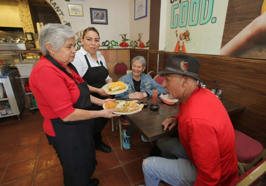 Longtime Somis Café and Market waitresses Angeles Garcia and Maria De La Cruz get ready to serve David and Annie Watkins, of Camarillo, their food. Garcia has been working there 21 years while De La Cruz has been there for 38. The Somis Café and Market first opened in 1974 and at 3319 Somis Road.