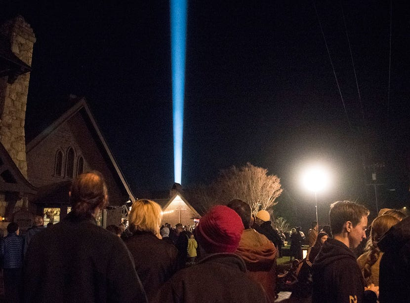 A beam of light shoots skyward from All-Saints By-the-Sea Episcopal Church on Wednesday night during an event commemorating the Jan. 9 debris flows in Montecito that claimed 23 lives.