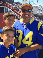 Rams fan Joey Velasco and sons Brandon and JoJo are looking forward to attending Saturday night's NFC divisional playoff game between the Rams and Dallas at the Coliseum.