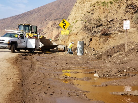 Crews work to clear drainage pipes along Pacific Coast Highway in Ventura County Friday ahead of a storm that was expected to hit the area by early evening