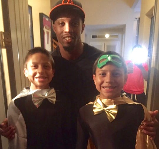 One of Cowboys fan Bob Froio's neighbors in Simi Valley was former Rams and current Cowboys receiver Tavon Austin, who posed for a picture with Froio's twin sons on Halloween in 2016. Dallas plays against the Rams in the NFC divisional playoffs on Saturday night at the Coliseum.