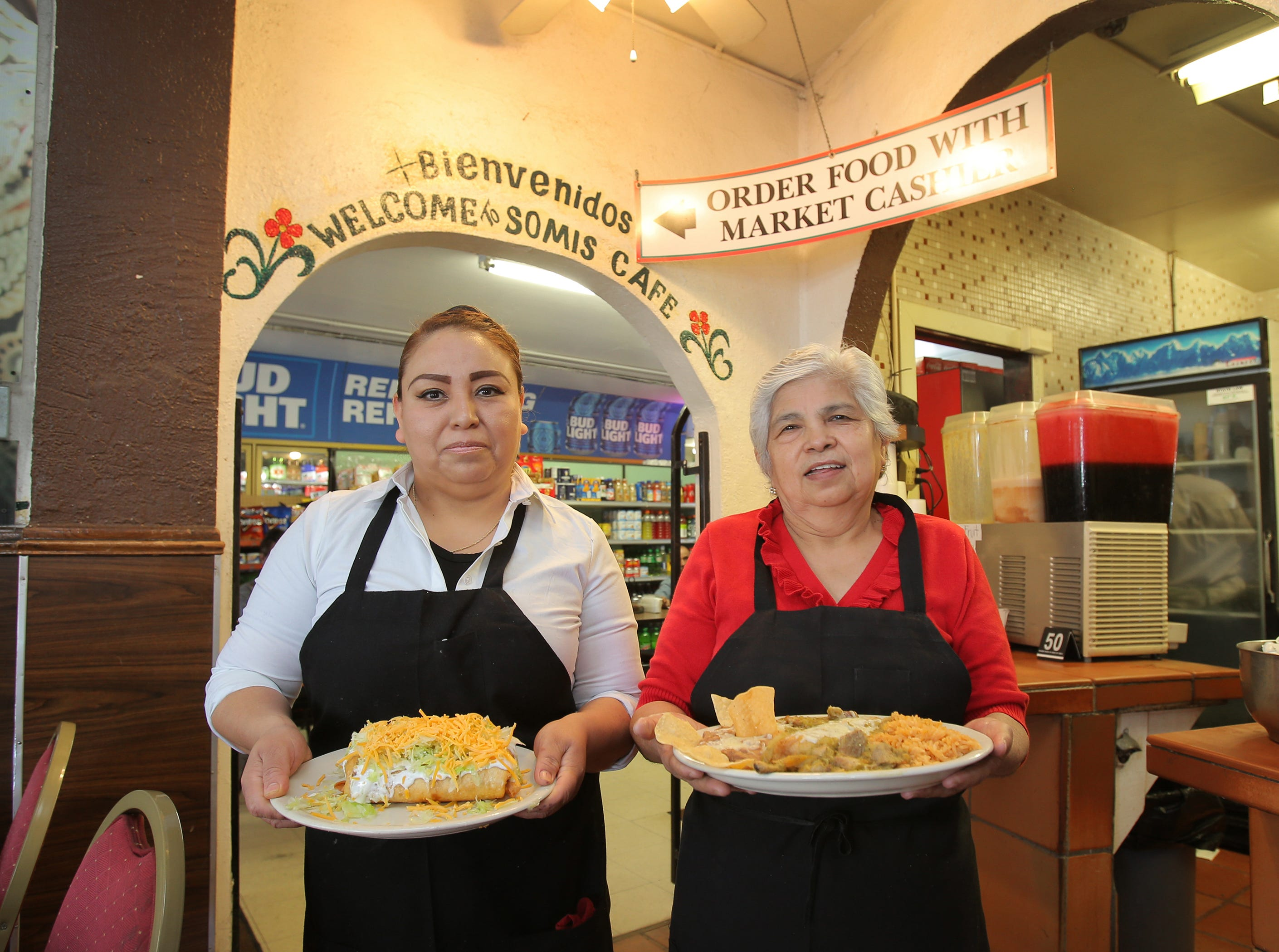 Longtime Somis Café and Market waitresses Angeles Garcia and Maria De La Cruz get ready to serve the café's two popular dishes, a chimichanga and a chile verde plate. Garcia has been working there 21 years while De La Cruz has been there for 38 years. The Somis Café and Market first opened in 1974 and is at 3319 Somis Road.