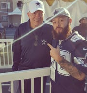 Cowboys fan Bryan Stange of Oxnard poses with Cowboys owner Jerry Jones at Dallas' training camp at River Ridge in Oxnard. Dallas plays against the Rams in the NFC divisional playoffs  Saturday night at the Coliseum.