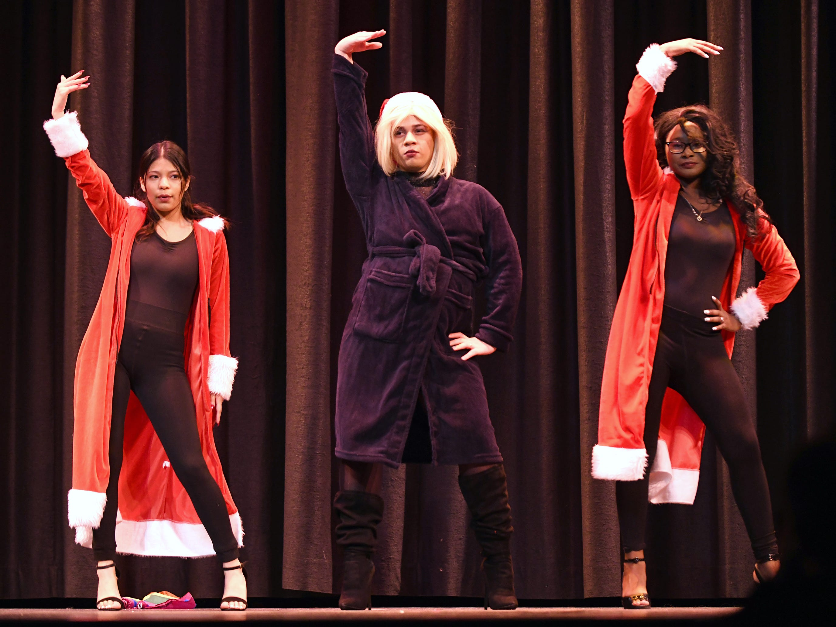 Isaac Rodriguez (center) performs during the talent portion of Mr. Vineland 2019 at Vineland High School on Thursday, January 10.
