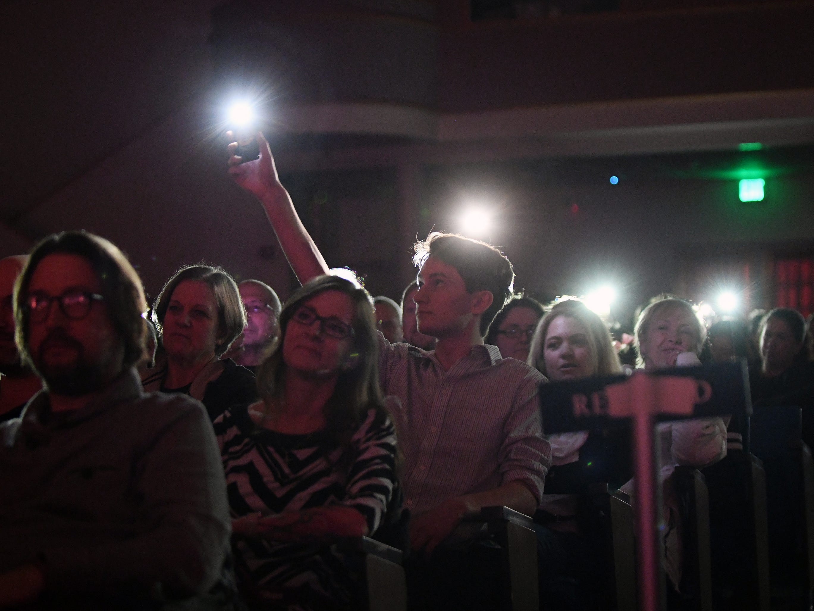 Some of the audience members held up lights during the talent portion of Mr. Vineland 2019 at Vineland High School on Thursday, January 10.