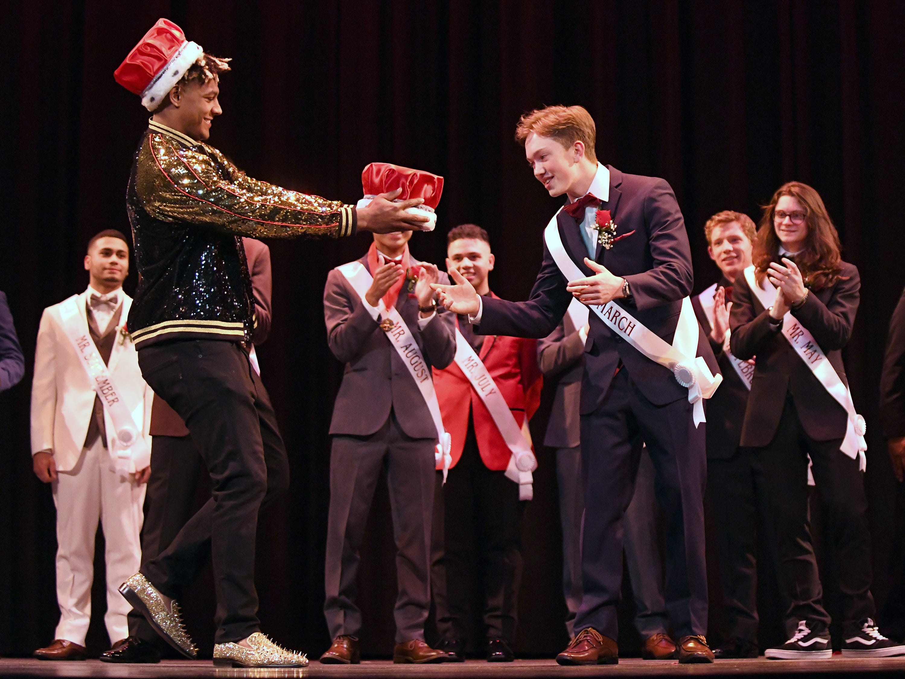 "Mr. Vineland 2019, Brandon ""Bubba"" Beyer, is awarded his crown by last year's Mr. Vineland winner, Isaih Pacheco at Vineland High School on Thursday, January 11."