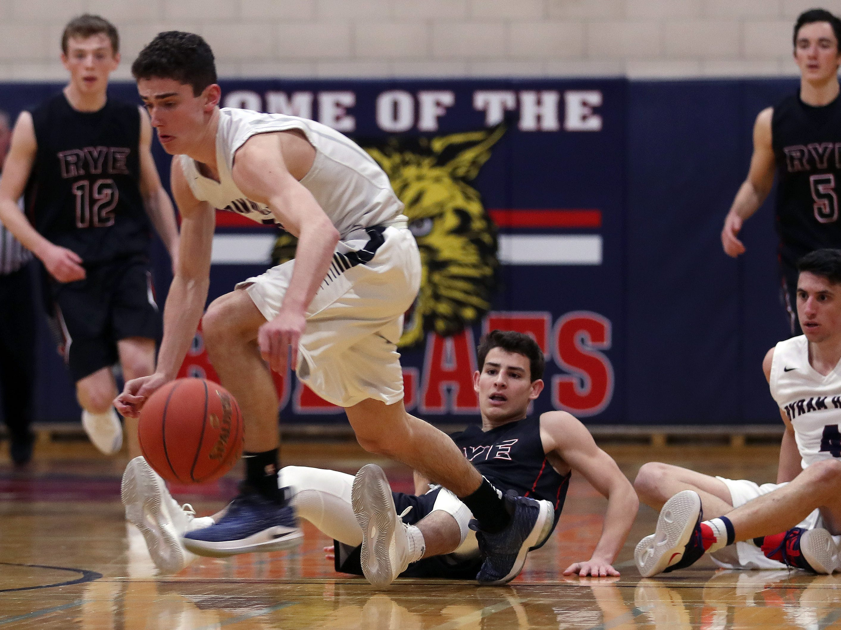 Byram Hills' Sam Goldman (5) comes away with a loose ball against Rye during boys basketball action at Byram Hills High School in Armonk Jan. 10, 2019. Byram Hills won the game.