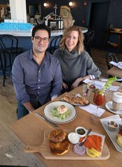 Pre-coronavirus times: Paul Molakides and his wife Jennifer Aaronson  pictured with brunch dishes at Boro 6 Wine Bar in Hastings-on-Hudson.