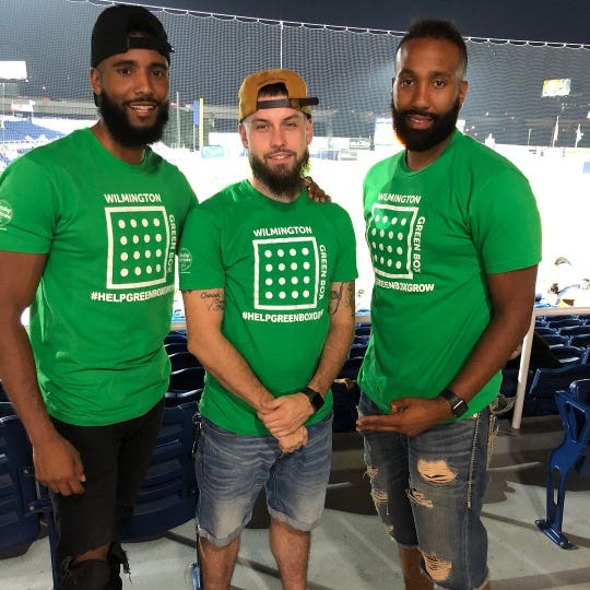 James L.A. Thompson (left) with fellow Wilmington Green Box co-founders John Naughton (center) and Jason Aviles at Frawley Stadium last year after their non-profit received a $15,000 donation from Capital One.