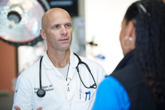 Dr. Bruce Nisbet at Saint Francis Hospital consults another medical professional in the Emergency Department.