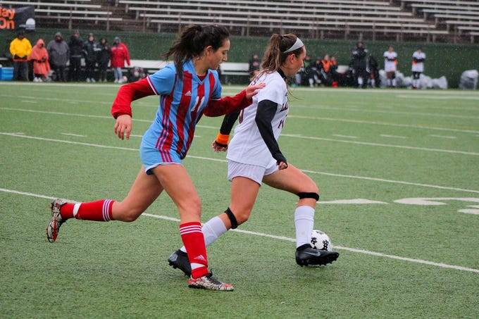 Hirschi's Jazmine Chavarria and Old High's Alyssa Salinas fight for the ball up the sideline. Old High defeated Hirschi 6-0 at Memorial Stadium on Friday.