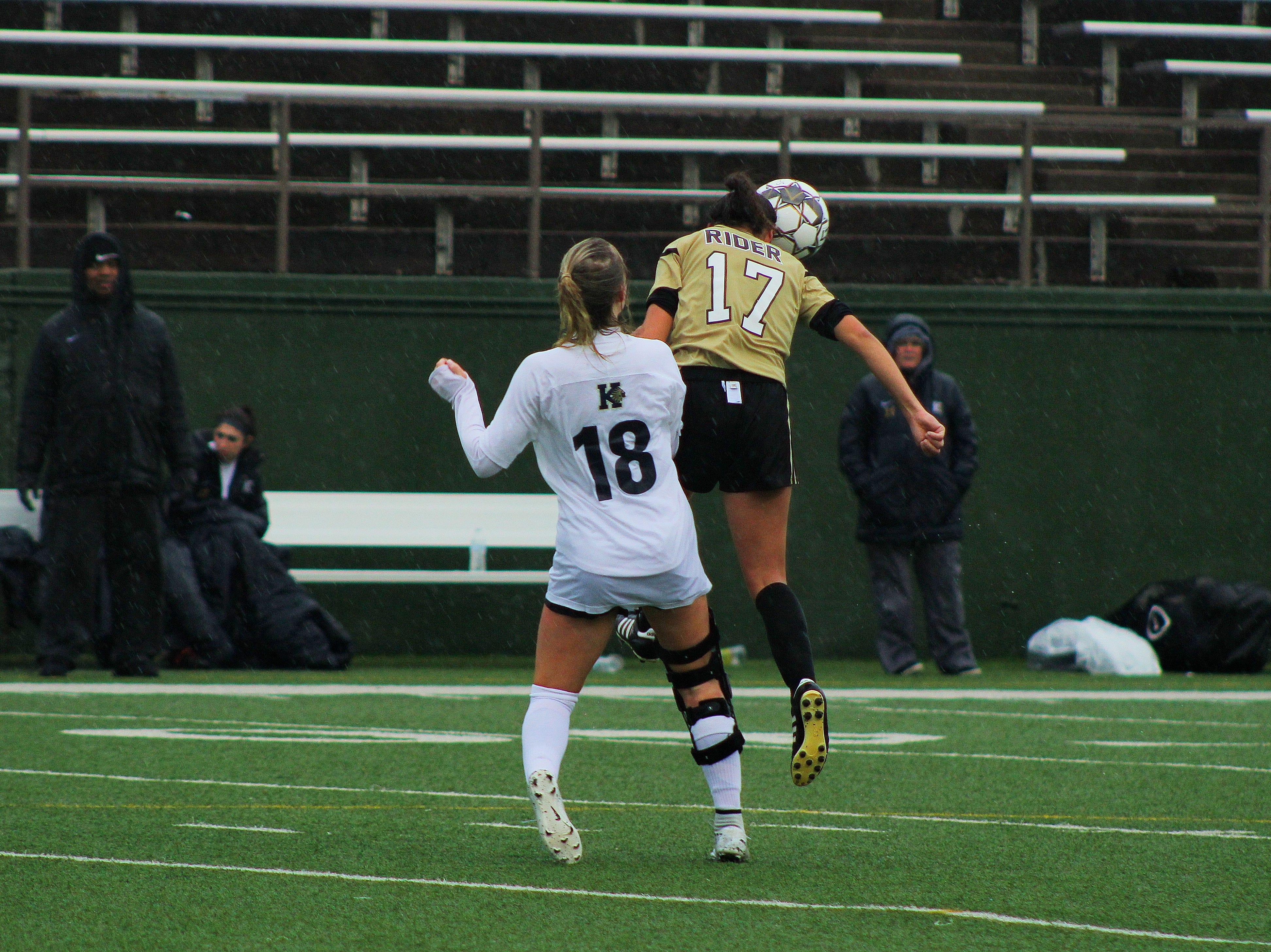 Freshman Jadyn Lopez heads the ball against Keller's Lucy Meadows.