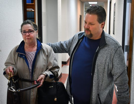 Jason Wayne Carlile and his mother, Joanne Ames, arrive at 78th District Court Friday morning for a pretrial hearing. Judge Barney Fudge set a trial date for June 3, 2019.