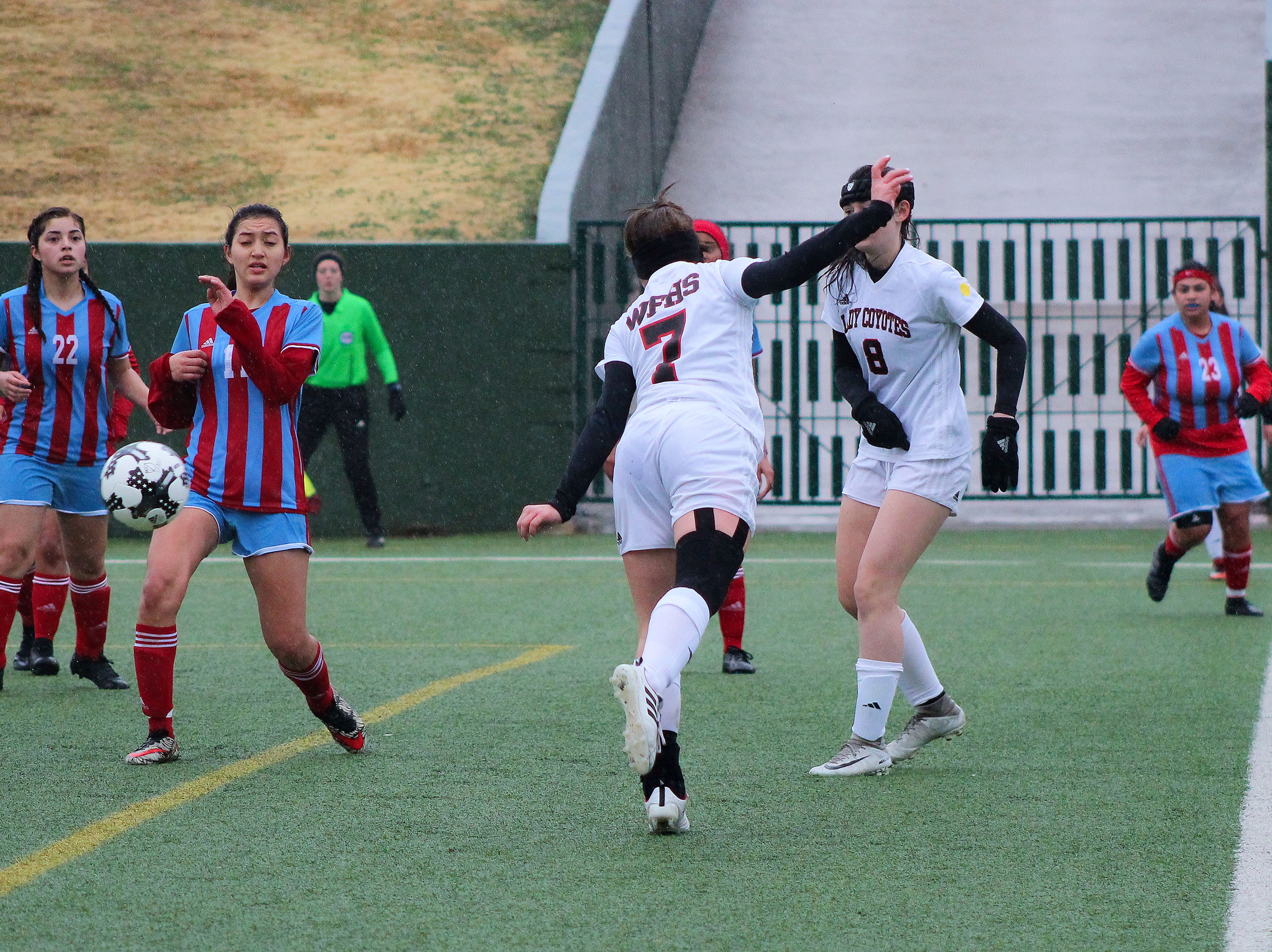Lucy Hood heads the ball towards the net for Old High in their match against Hirschi at a rainy Memorial Stadium.