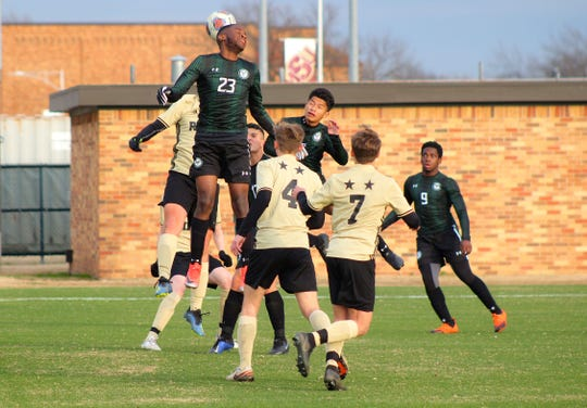 Lake Ridge's Justin Woodard goes up for the header against Rider in the Mustangs' Invitational.