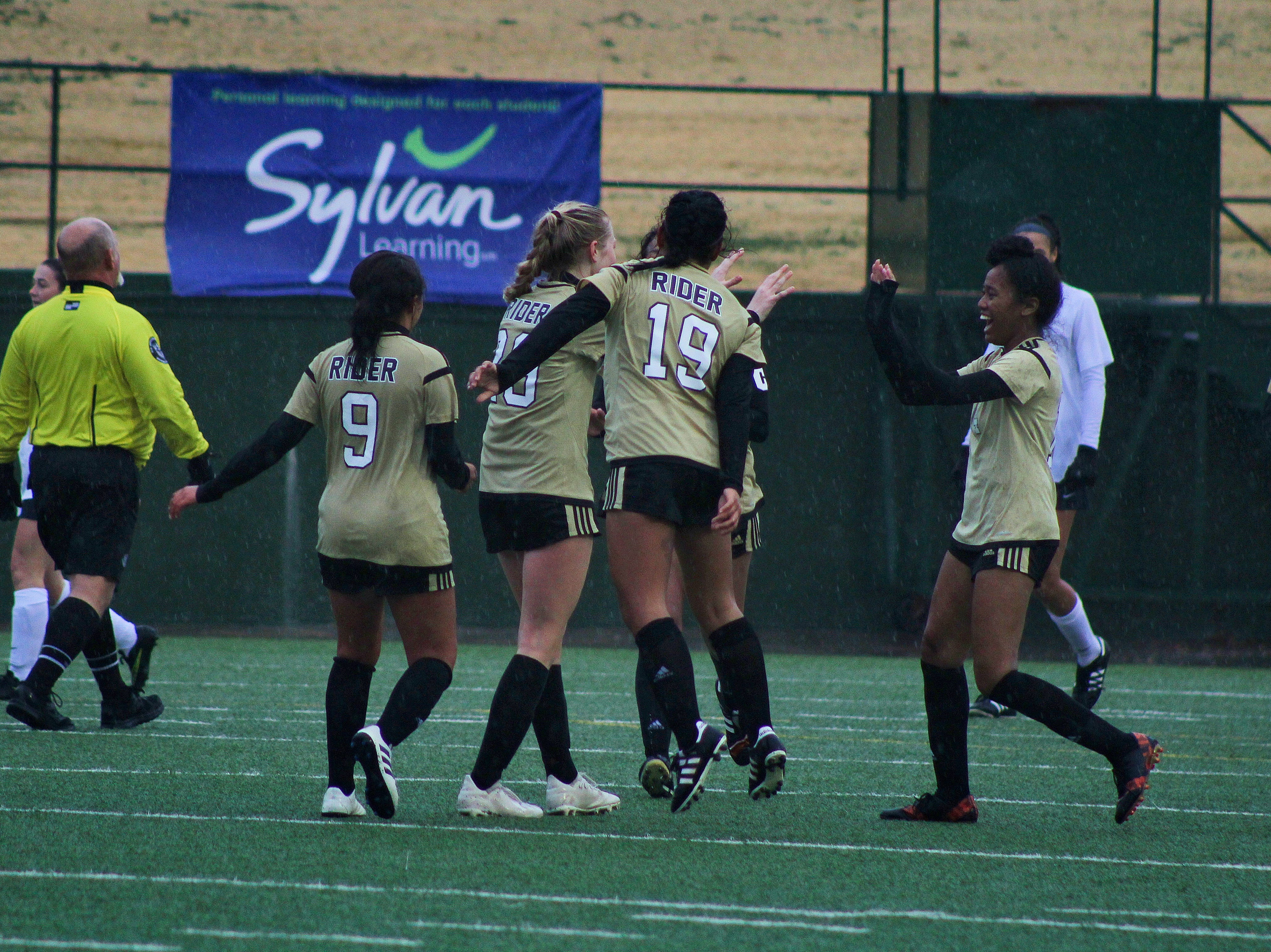 Rider celebrates after Mindy Shoffit scores from a free kick to seal the 1-0 victory.