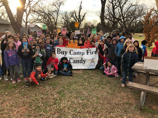 Members of Camp Fire prepare to kick off the 2019 annual candy sale, which runs Jan. 24 through Feb. 17.