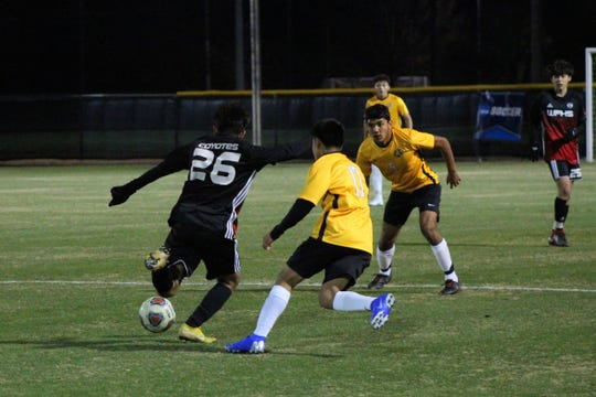 Old High's Julio Vasquez dribbles against Mount Pleasant's Osbaldo Benitez in the Coyotes' 4-2 victory.