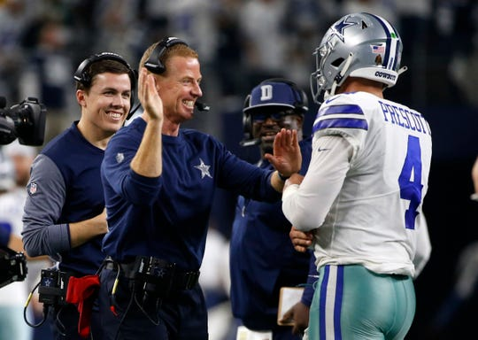 Dallas Cowboys head coach Jason Garrett, left, and quarterback Dak Prescott, right, celebrate a score against the Seattle Seahawks during last week's 24-22 victory in an NFC wild-card playoff game.