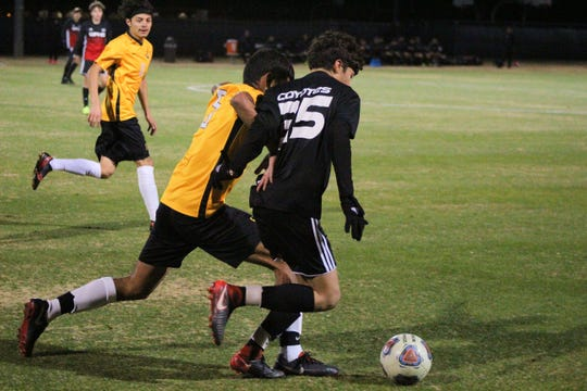 Old High's Armando Saldana battles with Mount Pleasant's Brian Ramirez in the Mustang's Invitational Thursday night. The Coyotes defeated Mount Pleasant 4-2.