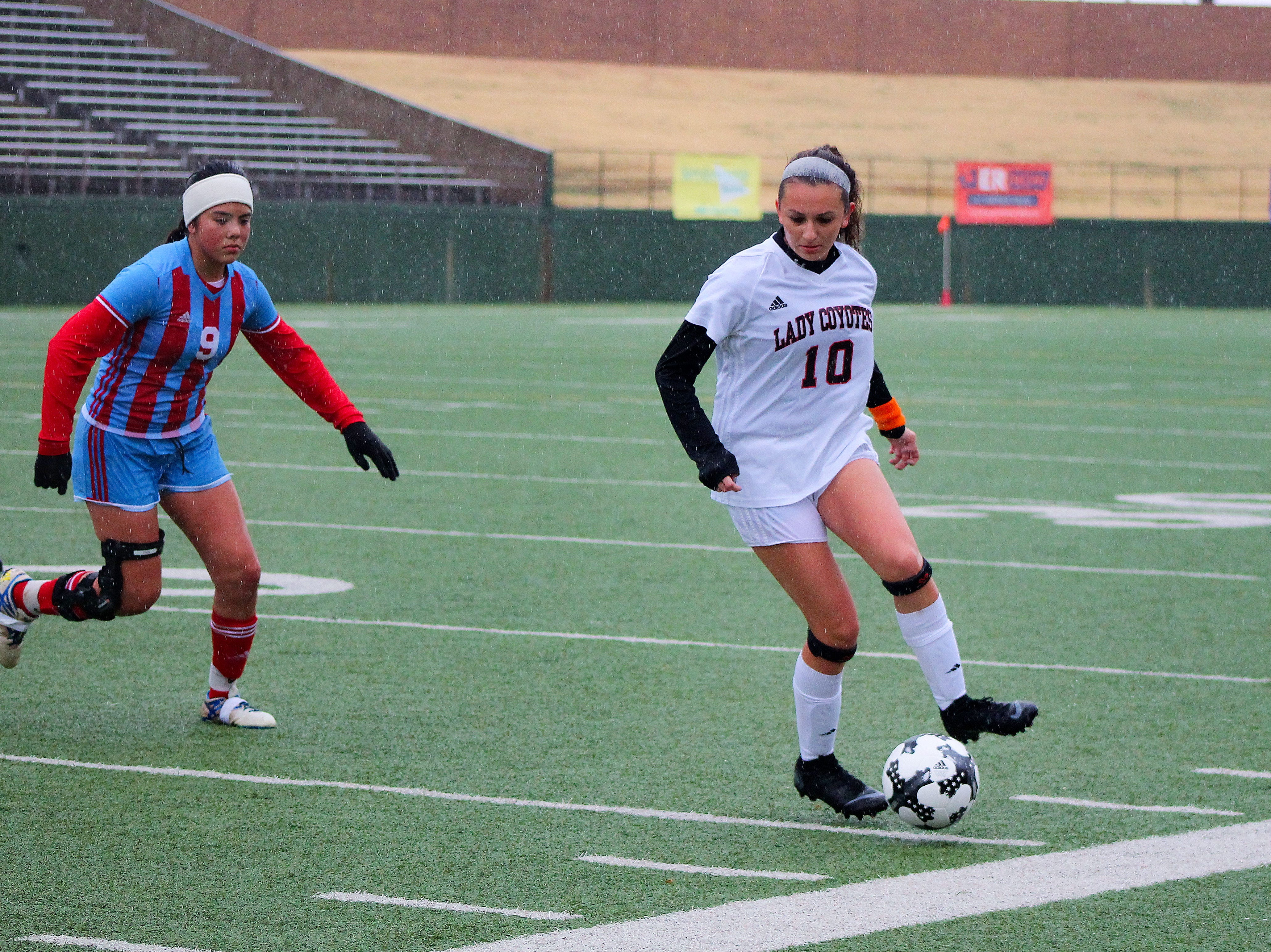 Old High's Alyssa Salinas dribbles the ball in the Coyotes 6-0 victory against the Hirschi Huskies.