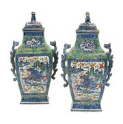 A pair of clobbered Chinese urns decorated with blue-and-white pictures of houses and a river were overpainted with colored flowers, leaves and a cracked ice design. The pair sold for $5,750.