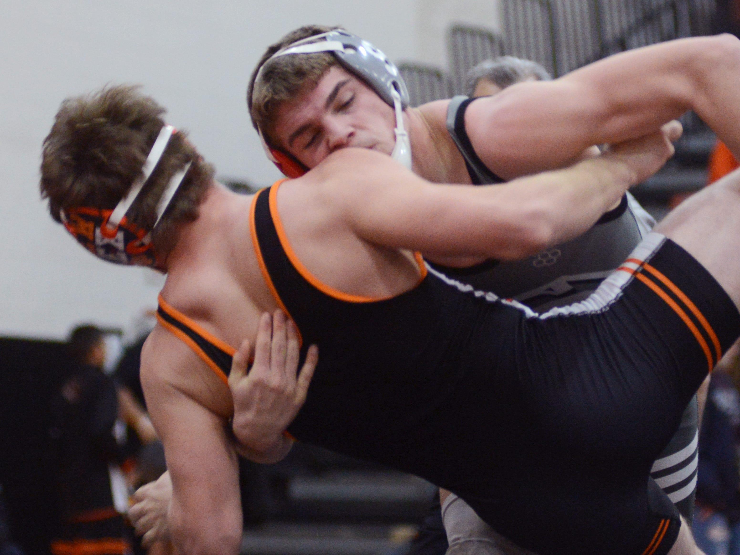 Sheridan's Jordan Barnett takes down New Lexington's Brandon Hinerman at 152 pounds.