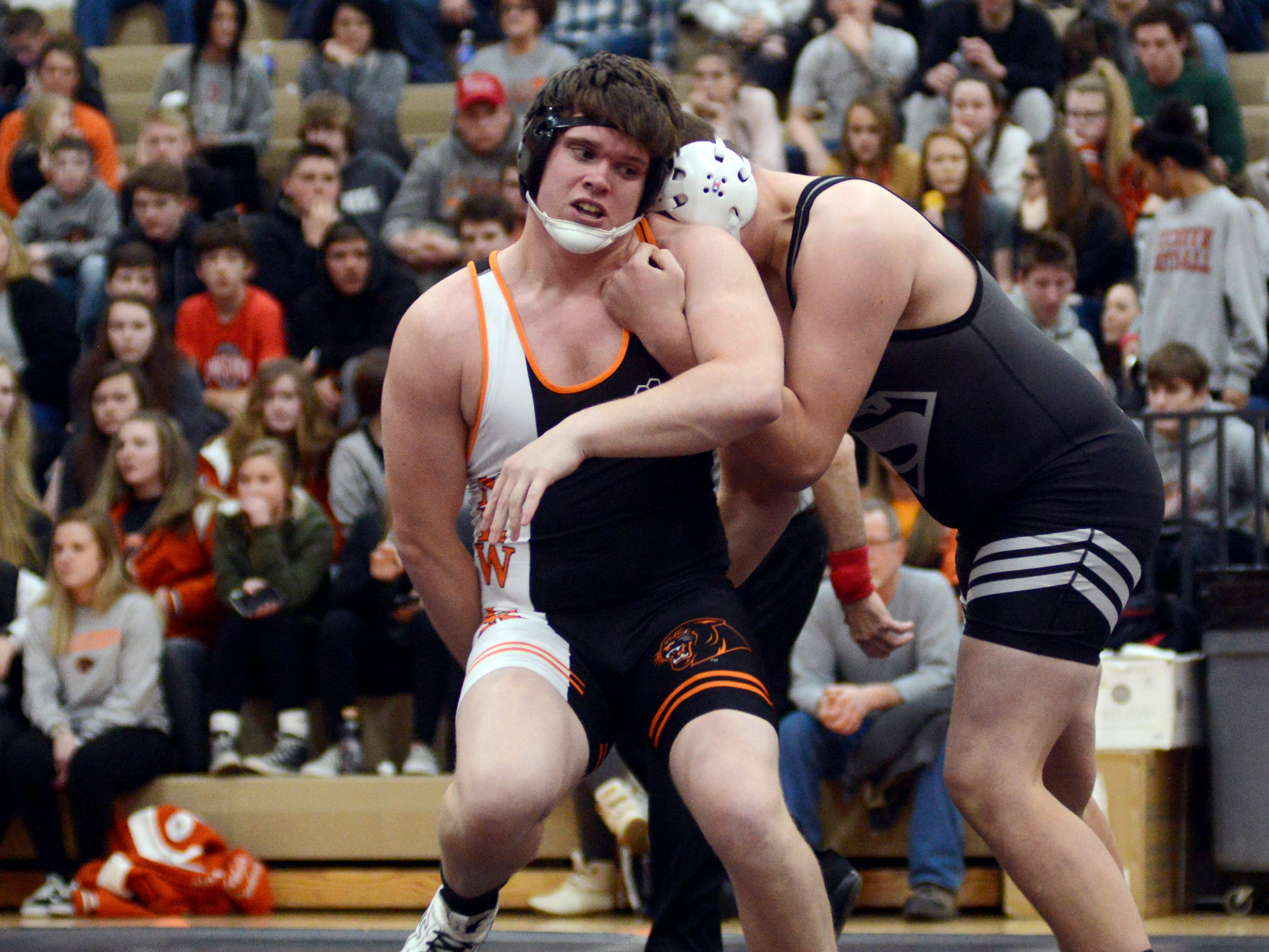 New Lexington's Cole Gilligan ties to escape Sheridan's Logan Morris at 220 pounds. Morris earned a late third period pin to win the match.