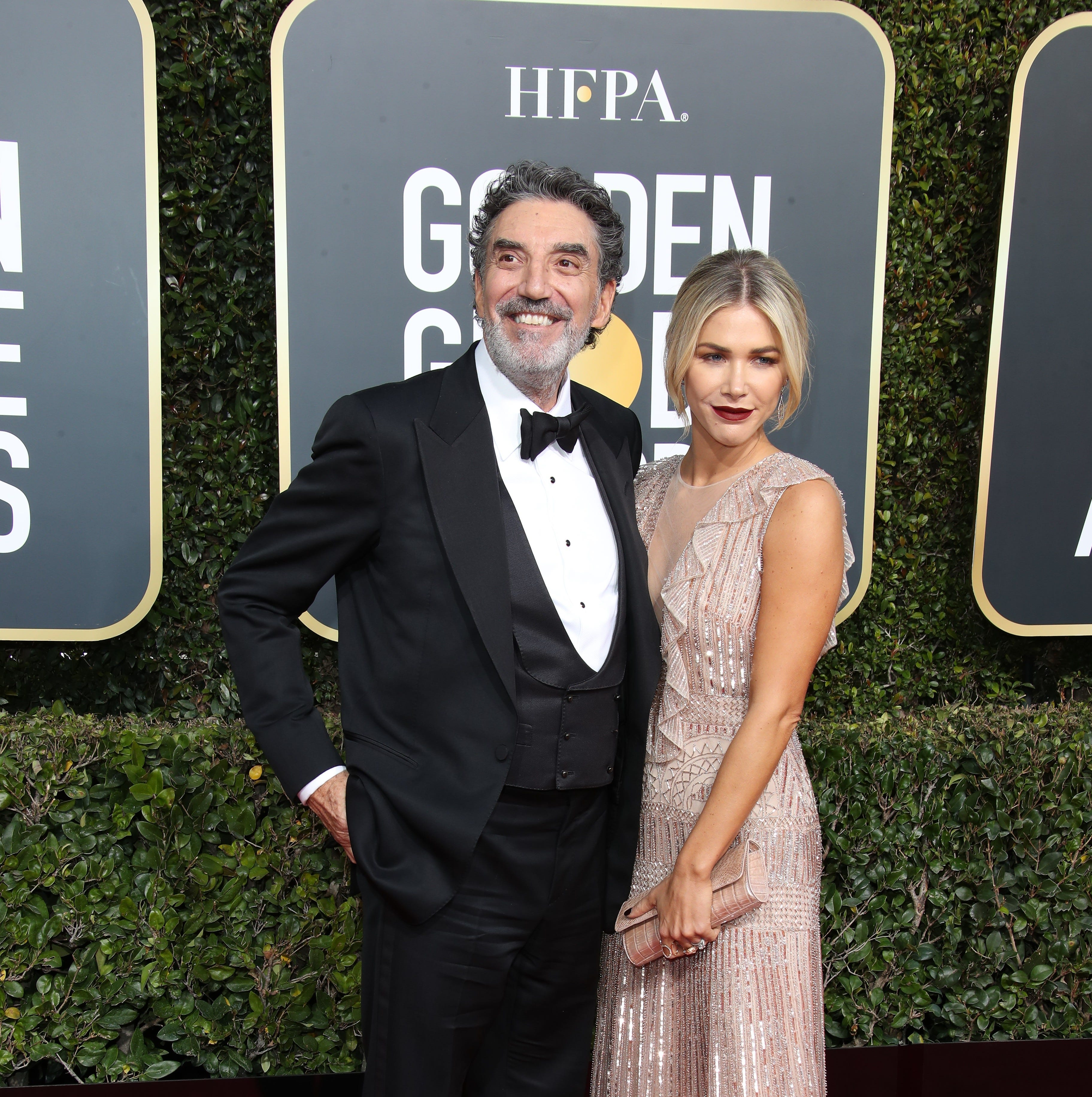 Jan 6, 2019; Beverly Hills, CA, USA; Chuck Lorre, left and Arielle Mandelson arrive at the 76th Golden Globe Awards at the Beverly Hilton. Mandatory Credit: Dan MacMedan-USA TODAY NETWORK (Via OlyDrop)