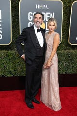 Chuck Lorre, left and Arielle Mandelson arrive at the 76th Golden Globe Awards at the Beverly Hilton.
