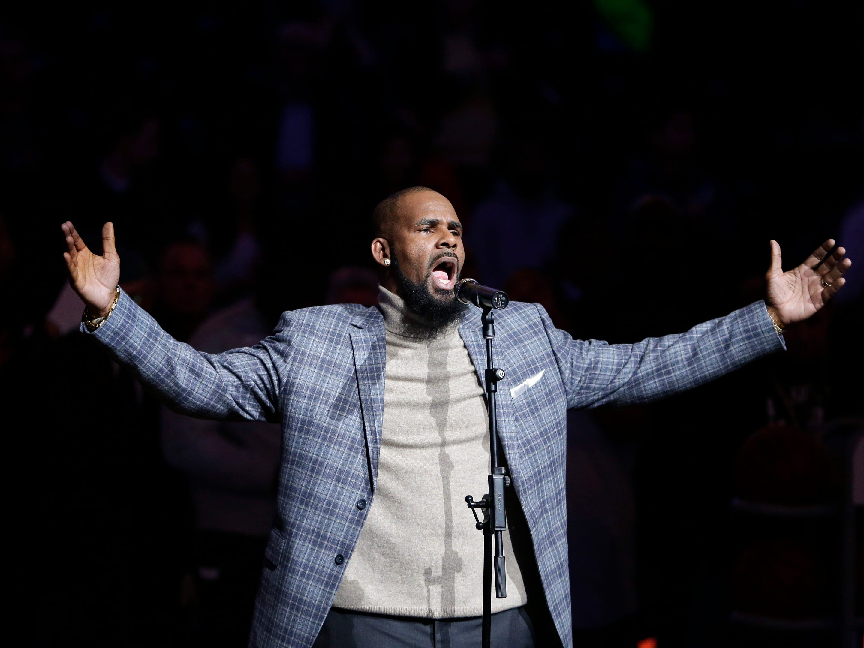 R. Kelly performs the national anthem before an NBA basketball game between the Brooklyn Nets and the Atlanta Hawks in New York on Nov. 17, 2015.