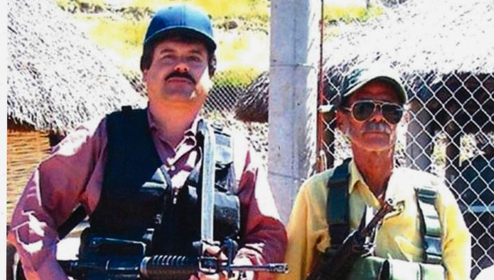 "In this undated photo provided by the United States Attorney's Office for the Eastern District of New York, Joaquin ""El Chapo"" Guzman, left, poses with an unidentified man. Text messages sent by the Mexican drug lord known as El Chapo about narrowly avoiding capture in 2012 have become the latest damaging evidence at his U.S. trial. Prosecutors presented the texts Wednesday, Jan. 9, 2019 in federal court in Brooklyn, where Guzman has pleaded not guilty to drug-trafficking charges."
